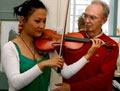 Brian McNamara, Alexander Teacher, helping a violin player