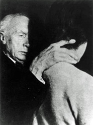 Picture of F. M. Alexander guiding a woman's neck with his hand