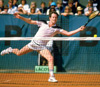 John McEnroe, tennis champion, playing a shot