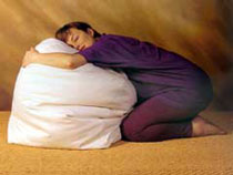 Picture of pregnant woman relaxing on a bean bag
